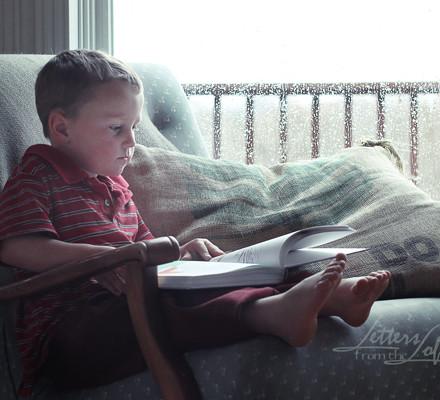 boy reading rainy day 2
