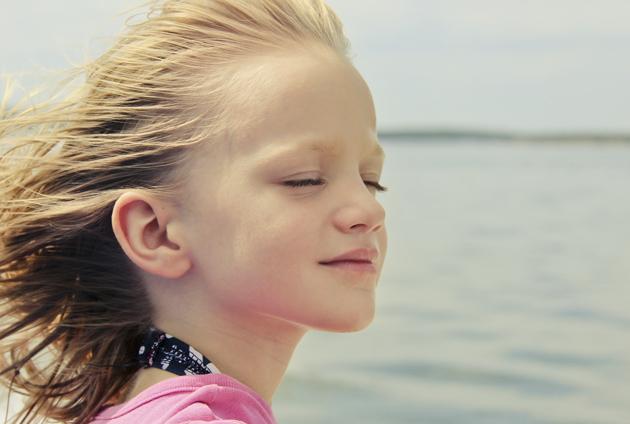 wind blowing through childs hair