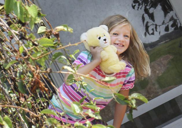 girl with stuffed bear