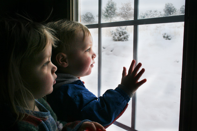 twins looking at snow